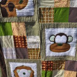 monkey, lion, and girraffe crib quilt